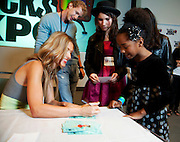 "Los Angeles, California: Audrina Partridge (The Hills) signs autographs for  Lucy Angelo (pink), Naynay Kirby (polkadot) Star Austria (leather coat) after a screening of her new show  at ""Reality Rocks: Los Angeles"" first reality show convention, 4/10/11 (Photo: Ann Summa)."