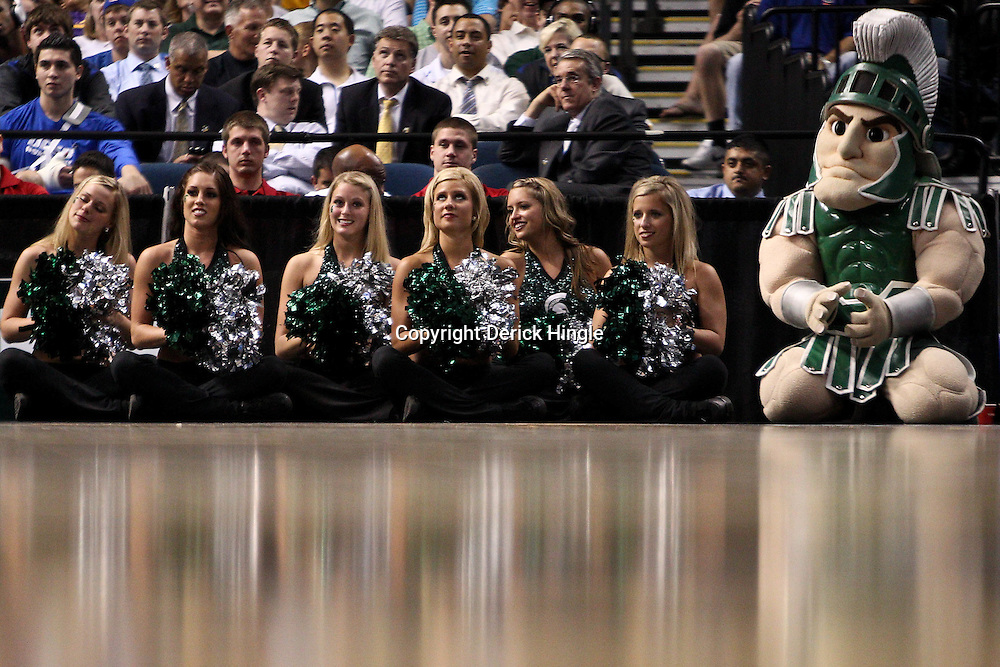 Mar 17, 2011; Tampa, FL, USA; Michigan State Spartans cheerleaders watch courtside during the first half of the second round of the 2011 NCAA men's basketball tournament against the UCLA Bruins at the St. Pete Times Forum.  Mandatory Credit: Derick E. Hingle