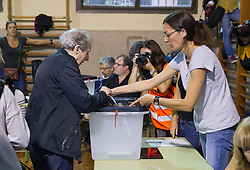 "© Licensed to London News Pictures. 01/10/2017. Barcelona, Spain.  <br /> <br /> One of the first person voting at Sedeta de Gracia´s Centre Civic.<br /> <br /> Students, their parents, associations and neighbours have organized to carry out ""playful activities"" during the weekend and keep open the Sedeta de Gracia´s Centre Civic.<br />  <br /> Since early in the morning dozens of people wait at the college´s door for the voting time under the rain.<br /> <br /> Mossos d´Escuadra said they won´t do nothing if that can destabilize social order.<br /> <br /> Catalonia is awaiting for today, October 1st, when the Spanish Region wants to vote in a self-determination referendum to get a independence.<br /> <br /> The Referendum´s Law was passed on last September 6th at the Catalonian Parliament thanks to the votes of ""Junts pel Sí"" and ""CUP"". Then it was suspended by the Spanish Constitutional Court, on next day.<br /> Carles Puigdemont, the President of the Government of Catalonia, said he would ignore that and he and his Government will continue with the Referendum.<br /> <br /> The Spanish Government has sent to Catalonia thousands of ""Guardia Civil"" and ""Policía Nacional"" officers (two of the Spanish forces and state security forces), to enforce the ruling of the Constitutional Court and avoid the voting process on next Sunday. They will work with the Mossos d´Escuadra (the Autonomic police in Catalonia).<br /> <br /> To avoid the vote, the Spanish Government has prevented the opening of polling stations, some of which are schools.  <br /> <br /> Photo credit: Gustavo Valiente/LNP"