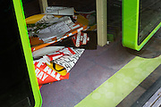 Posters and price details seen on the floor of the now-closed music and DVD shop Zavvi, seen in Bradford city centre, Yorkshire - a victim of the UK's economic recession.