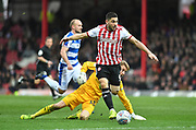 Brentford forward Neal Maupay (9) skips past Queens Park Rangers keeper Joe Lumley before setting up the second goal for Brentford forward Saïd Benrahma (21) *** during the EFL Sky Bet Championship match between Brentford and Queens Park Rangers at Griffin Park, London, England on 2 March 2019.