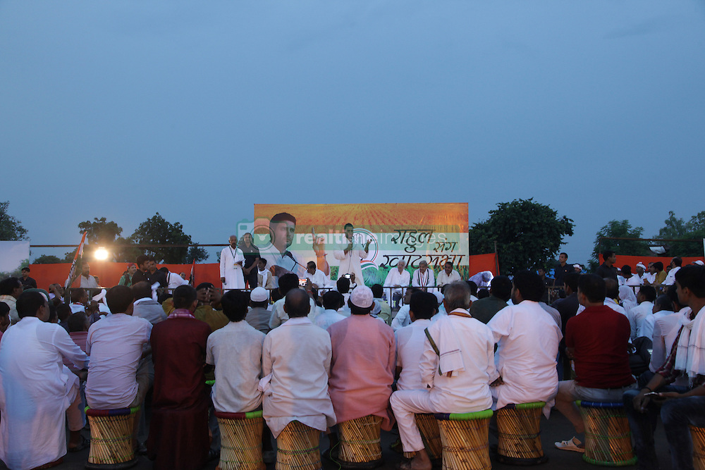 September 16, 2016 - Kaushambi, India - Indian Congress party's vice president and leader Rahul Gandhi addresses a public meeting, popularly known as Khaat Panchayats, where organizers make arrangement of thousands of Khaats (cots) for the people attending the meetings to sit on them, while listening to their leader, in tenwa village , in Kaushambi on September 15, 2016.Khaat (rustic Hindi word for cot) is symbol of villages in general and of farmers in particular. By naming the public meetings as Khaat Panchayats arranging khaats during the meetings, a strategy has been drawn to connect Rahul and Congress with the farmers of Uttar Pradesh and thus reap the electoral harvests during the next assambly elections. (Credit Image: © Ritesh Shukla/NurPhoto via ZUMA Press)