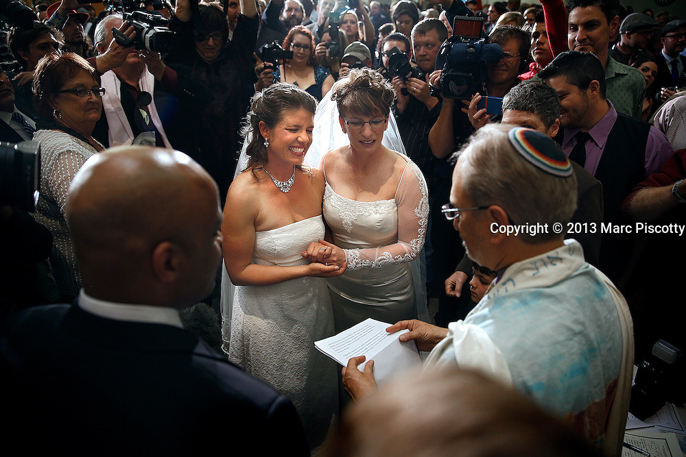 DENVER, CO - MAY 1: Anna, left, and Fran Simon, both of Denver, Colorado, were the first to be issued a Civil Union license at a midnight ceremony as hundreds watched on in the Denver Office of the Clerk and Recorder at the Wellington E. Webb Municipal Office Building on May 1, 2013 in Denver, Co. State lawmakers passed the Civil Unions bill granting unmarried couples, both gay and heterosexual, rights similar to marriage and Colorado becomes the sixth state to allow civil unions.  (Photo by Marc Piscotty / ©2013)