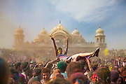 A female crowd surfs in front of the Lotus Temple, in Spanish Fork, Utah, during the Holi Festival of Colors, on Saturday, Mar. 24, 2012, at (Photo by Benjamin B. Morris ©2012)
