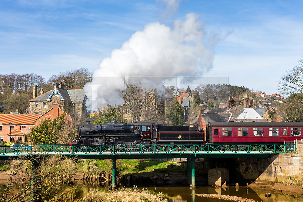 © Licensed to London News Pictures. 09/04/2018. Ruswarp, UK. The 1957 Steam Locomotive 76079 travels across the River Esk in the village of Ruswarp in The North Yorkshire Moors this morning on it's way from Whitby to Pickering. The engine built in 1957 & is a BR Standard 4, Built in Horwich & designed by Robert Riddles, it worked British Railways lines for 10 years before retirement. Photo credit: Andrew McCaren/LNP