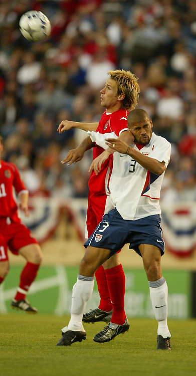 SAN JOSE, USA - Tuesday, May 27, 2003: Wales' Gareth Taylor and USA's C.J. Brown during the Friendly International match at the Spartan Stadium. (Pic by David Rawcliffe/Propaganda)
