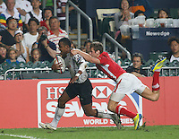 HONG KONG, HONG KONG : Samisoni Viriviri of Fiji scores as he is being brought down by Alex Webber of Wales in Fiji's 26-19 win in the Cup Final, to defend their Hong Kong Rugby Sevens title, shown in Hong Kong on Sunday, 24 March, 2013.