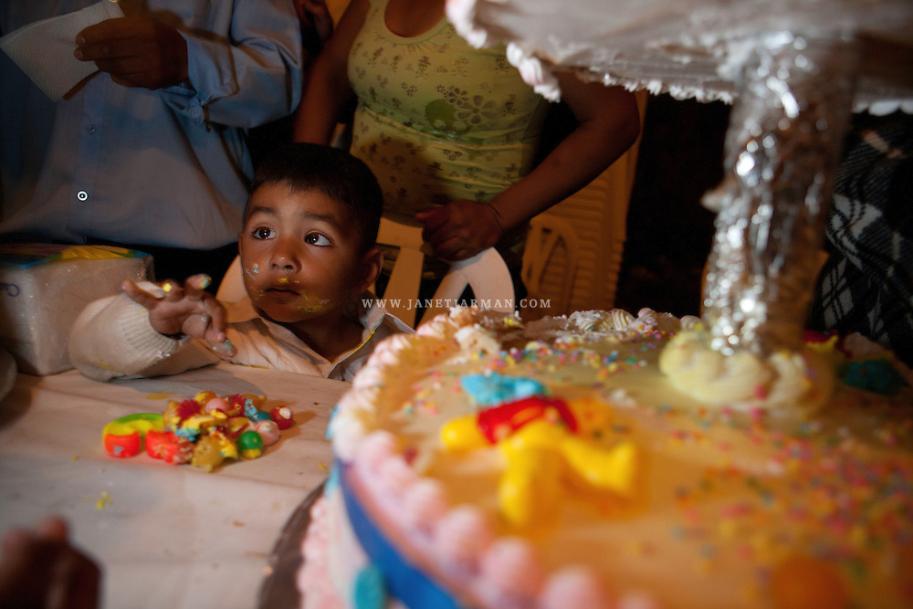 Hidalgo, Mexico, 2008 – Carlos enjoys a cake served at a party following the baptism of him and his sister. Andrés and Marisol invited over 200 people to the event.  Even though they had no savings, they scraped together around $700 for the party, since Andrés wanted to give back to his community in Mexico, where baptisms are almost as important as weddings.