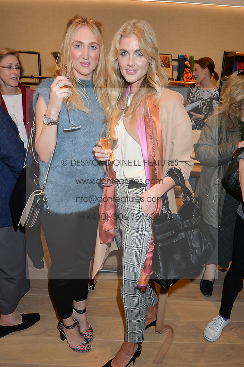 Left to right, sisters FRANCESCA AIR and DONNA AIR at a party to celebrate the re-opening of the Jaeger Chelsea Store in association with the NSPCC at 145 Kings Road, London on 24th September 2014.