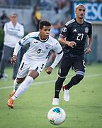 Cuba defender Dariel Morejon (5) dribbles past Mexico defender Luis Rodriguez (21) during a CONCACAF Gold Cup soccer match in Pasadena, Calif., Saturday, June 15, 2019. Mexico defeated Cuba 7-0. (Ed Ruvalcaba/Image of Sport)