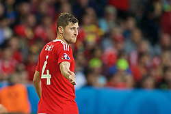 LILLE, FRANCE - Friday, July 1, 2016: Wales' Ben Davies gestures during the UEFA Euro 2016 Championship Quarter-Final match against Belgium at the Stade Pierre Mauroy. (Pic by Paul Greenwood/Propaganda)