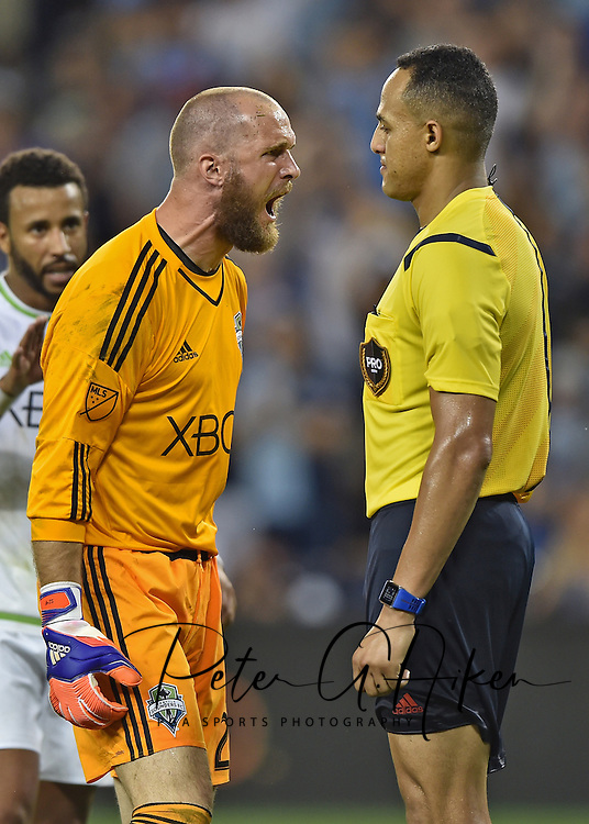Seattle Sounders FC goal keeper Stefan Frei (24) argues with referee Ismail Elfath (right) after receiving a foul call in the penalty box against Sporting KC during the second half at Sporting Park.