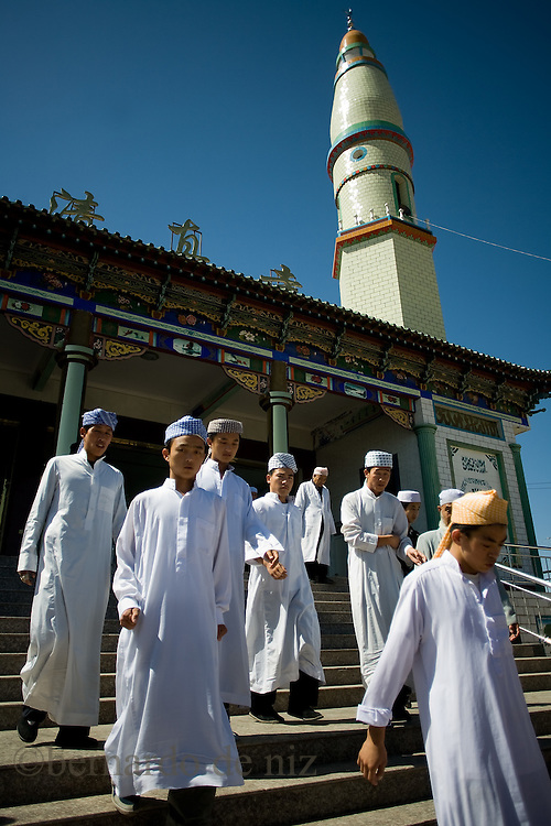 Chinese muslims walk outside of the  Dujia Tan Mosque in northwest China's Ningxia Hui Autonomous Region, China, on Thursday, September. 11, 2008. The islam is the second biggest religion in China, where there are between 20 and 30 millions of muslims.