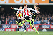 Brentford midfielder Ryan Woods (15) and Brighton & Hove Albion central midfielder Steve Sidwell (14) during the EFL Sky Bet Championship match between Brentford and Brighton and Hove Albion at Griffin Park, London, England on 5 February 2017.