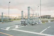 Dawn at the main entrance into Camp Schwab. Protesters started direct action in front of this gate in July, 2014. However, the movement to prevent the expansion of the US military base is nearly 18 years old.<br /> <br /> The US military has made the completion of the new base at Henoko a condition for closing the dangerous Marine Corps Futenma Air Station. The crash of a US Marine transport helicopter from Futenma into a university campus, located in a crowded neighborhood, on August 13 2004 was a terrifying reminder of what is at stake in this struggle. The Guardian has stated that the location of the military air station in Ginowan &quot;would be like having F22s landing in Hyde Park [London].&quot; By linking the closure of Futenma to the construction of the new air base, the Japanese government and the US military have offered Okinawa&rsquo;s urban residents the intolerable option of choosing whether to sacrifice their own safety, or their environmental heritage. Moving the military functions of Futenma to Henoko, moreover, merely shifts the affliction of the US base to other communities within Okinawa. Henoko, Okinawa, Japan.
