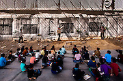 13th March 2014, Shakarpur, New Delhi, India. Teachers from left to right: Mr KK Gupta; Rajesh Kumar Sharma and Mr Laxmi Chandra at the blackboards at a makeshift school under a metro bridge near the Yamuna Bank Metro station in Shakarpur, New Delhi, India on the 13th March 2014<br /> <br /> Rajesh Kumar Sharma (born 01/02/1970), started this makeshift school in 2011. Six mornings a week he teaches underprivileged children for three hours while his younger brother replaces him at his general store in Shakarpur. His students are children of labourers, rickshaw-pullers and farm workers. This is the 3rd site he has used to teach under privileged children in the city, he began in 1997. <br /> <br /> PHOTOGRAPH BY AND COPYRIGHT OF SIMON DE TREY-WHITE<br /> + 91 98103 99809<br /> email: simon@simondetreywhite.com<br /> photographer in delhi<br /> journalist