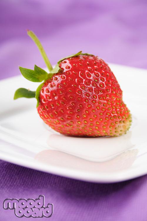 Strawberry on plate - studio shot