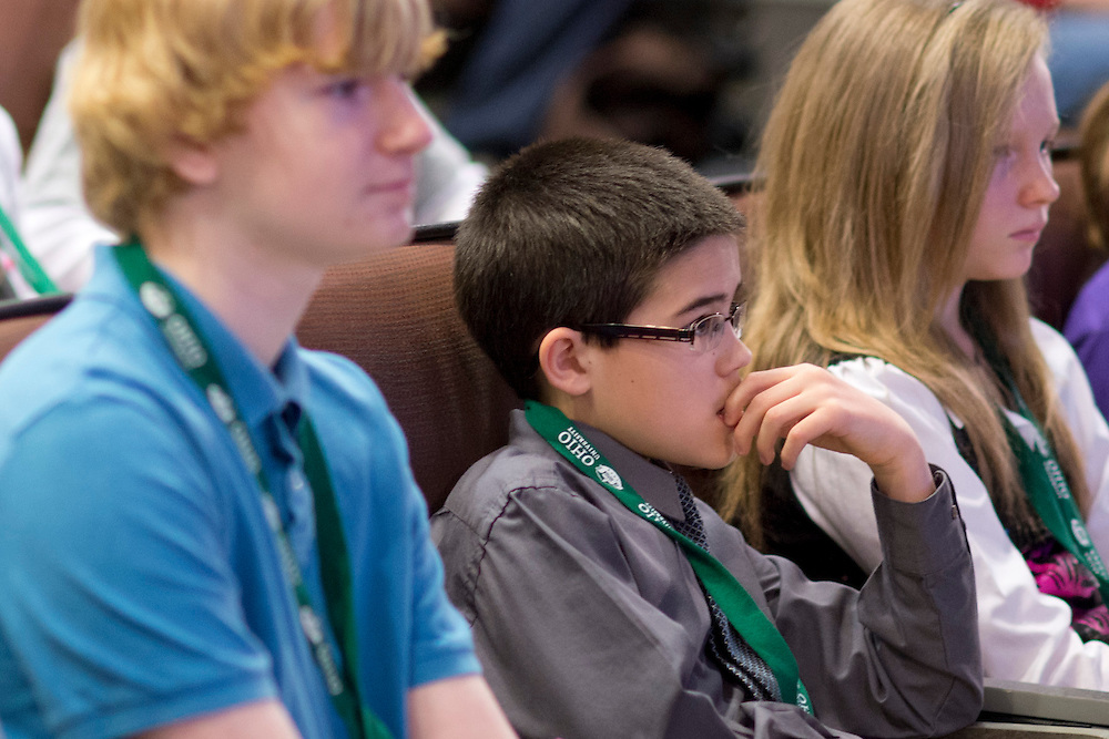 Noah Clemons, center, watches a fellow participant spell a word during the Southeast Ohio Regional Spelling Bee Saturday, March 16, 2013. The Regional Spelling Bee was sponsored by Ohio University's Scripps College of Communication and held in Margaret M. Walter Hall on OU's main campus.