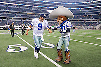 "06 November 2011: Quarterback (9) Tony Romo of the Dallas Cowboys celebrates with the Cowboys mascot ""Rowdy"" after defeating the Seattle Seahawks 23-13 at Cowboy Stadium in Arlington, TX."