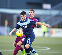 Arbroath's Martin Scott and Forfar Athletic's Lewis Milne. half time : Forfar Athletic 0 v 0 Arbroath, Scottish Football League Division Two game played 10/12/2016 at Station Park.