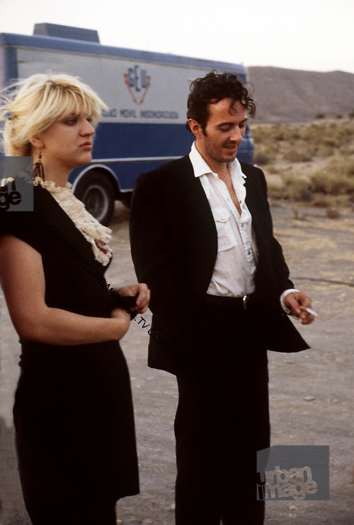 Courtney Love and Joe Strummer on the set of'Straight to Hell' by Alex Cox, 1986