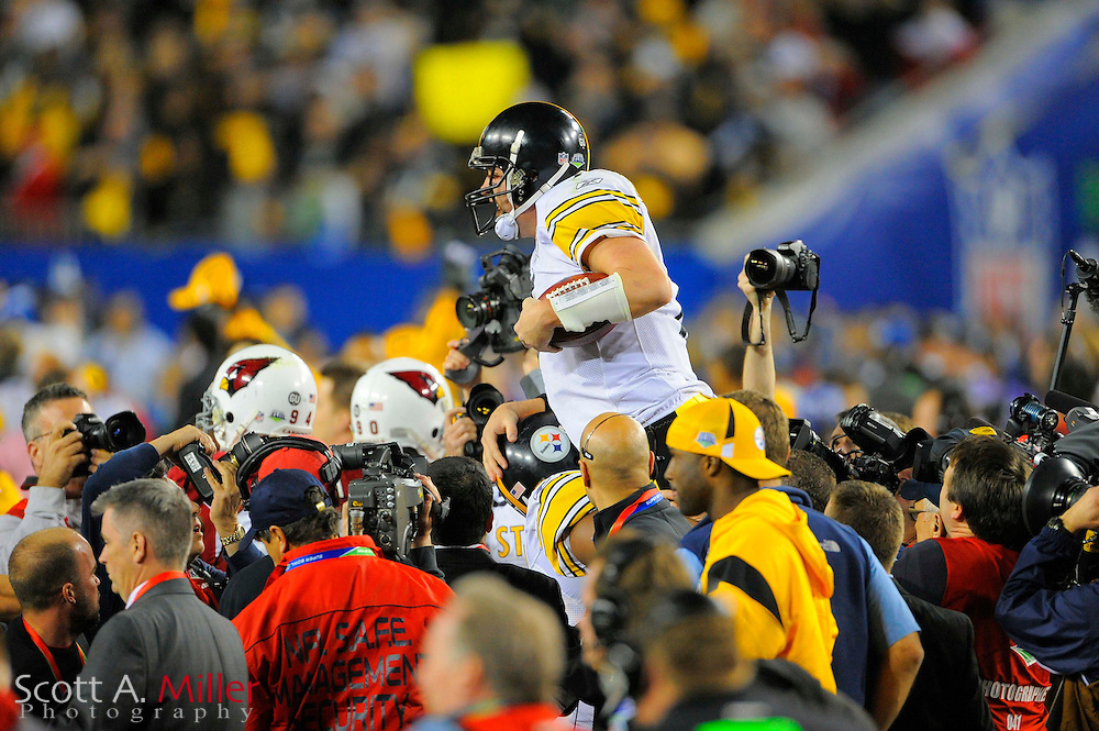 Feb 1, 2009; Tampa, FL, USA; Pittsburgh Steelers quarterback Ben Roethlisberger (top) is lifted after the game of Super Bowl XLIII against the Arizona Cardinals at Raymond James Stadium. The Steelers defeated the Cardinals 27-23.  ©2009 Scott A. Miller