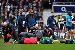 Mike Brown of England is treated for concussion during a break in play - Photo mandatory by-line: Patrick Khachfe/JMP - Mobile: 07966 386802 14/02/2015 - SPORT - RUGBY UNION - London - Twickenham Stadium - England v Italy - Six Nations Championship