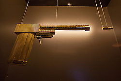 © licensed to London News Pictures. London, UK 05/07/2012. The golden gun, which have been used in The Man with the Golden Gun, being shown with many Bond items which have been used in the movies in the last 50 years at Designing 007 exhibition at Barbican Centre. Photo credit: Tolga Akmen/LNP