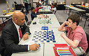 Harris County Department of Education Superintendent James Colbert plays chess with a student during a tournament between ABS East and ABS West, May 22, 2019.