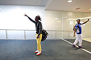 MELISSA LYTTLE   |   Times<br /> Dontrell &quot;Fred&quot; Johnson takes one last glance at his family and waves goodbye after passing through security and walking toward his gate at the airport, along with Pahokee teammate Rashaun &quot;Hunt&quot; Croney. Both will be starting for Ellsworth College a junior college in Iowa Falls, Iowa. Both also hope a little extra grooming will help their prospects of getting into a university with a good Division-1 football program.