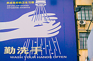 A sign Chinese and English encourage hand washing and better hygiene near the Bund, Shanghai, China.  Shanghai is one of China's most important cultural, commercial, financial, industrial and communications centers.  It is also one of the busiest ports in the world and is a major economic center.