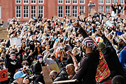 Protester kneel with fists in the air on the steps of the National Assembly For Wales during the Black Lives Matter protest in Cardiff, Wales on 6 June 2020.