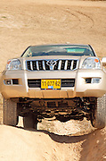 Toyota landcruiser, negotiating a steep dirt road hill, October 2006