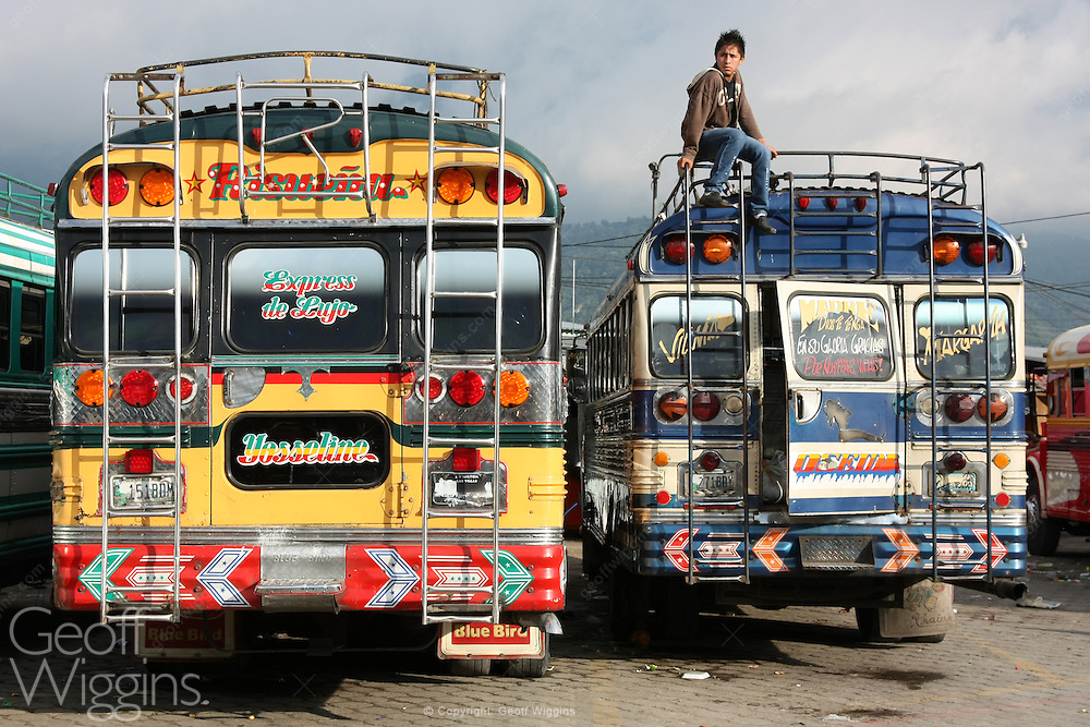 Rear view of decorated chicken buses at Antigua bus station, Guatemala, Central America