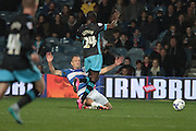 Queens Park Rangers defender Clint Hill tackles Sheffield Wednesday striker Moudou Sougou during the Sky Bet Championship match between Queens Park Rangers and Sheffield Wednesday at the Loftus Road Stadium, London, England on 20 October 2015. Photo by Jemma Phillips.