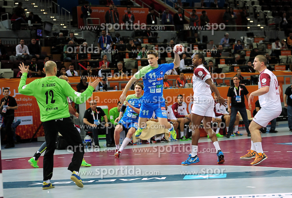 Jure Dolenec #11 of Slovenia during handball match between National Teams of Slovenia and Qatar at Day 5 of 24th Men's Handball World Championship Qatar 2015 on January 19, 2015 in Al Bin Hamad Al Attiya Arena, Doha, Qatar. Photo by Slavko Kolar / Sportida