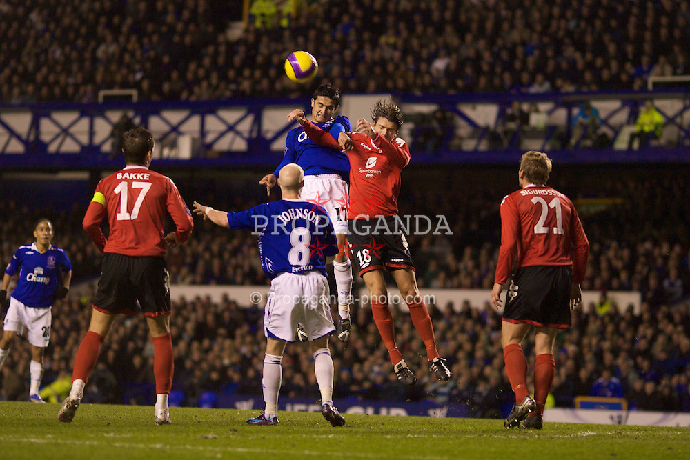 LIVERPOOL, ENGLAND - Thursday, February 21, 2008: Everton's Tim Cahill and SK Brann Bergen's Olafur Orn Bjarnason during the UEFA Cup Round of 32 2nd Leg match at Goodison Park. (Photo by David Rawcliffe/Propaganda)