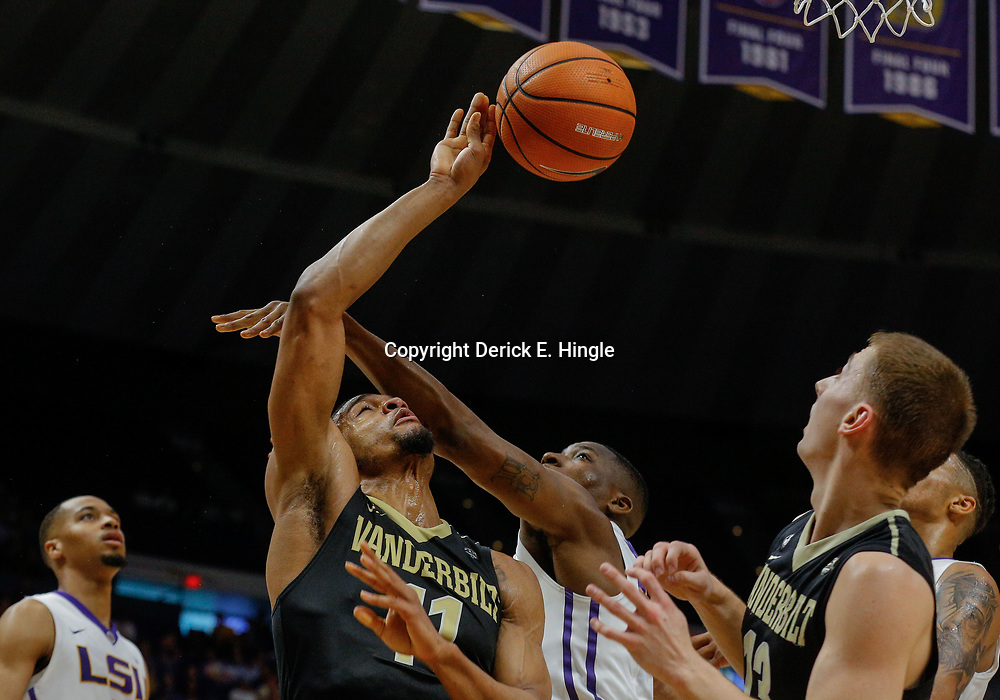 Feb 20, 2018; Baton Rouge, LA, USA; Vanderbilt Commodores forward Jeff Roberson (11) has his shot blocked by LSU Tigers guard Randy Onwuasor (14) during the first half at the Pete Maravich Assembly Center. Mandatory Credit: Derick E. Hingle-USA TODAY Sports