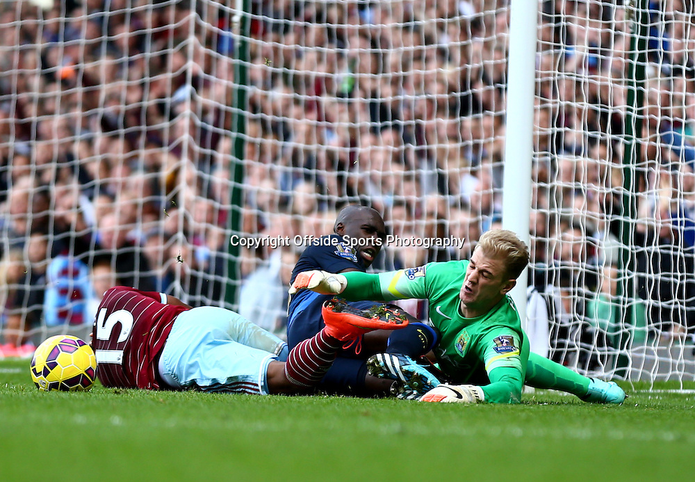 25 October 2014 - Barclays Premier League - West Ham v Manchester City - Joe Hart of Manchester City collied with Eliaquim Mangala and Diafra Sakho of West Ham - Photo: Marc Atkins / Offside.