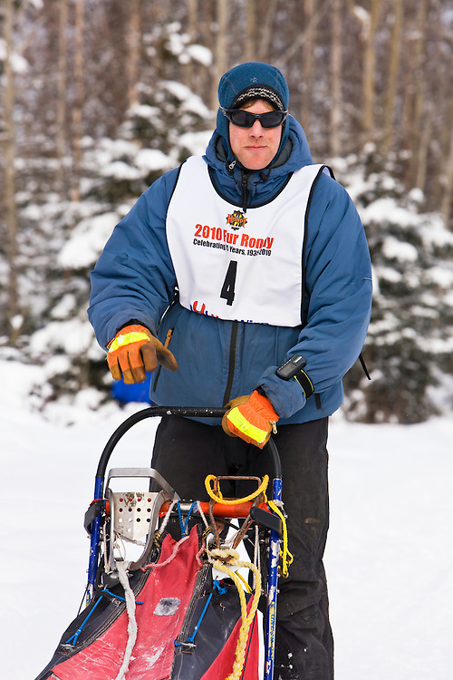 Musher Nils Hahn in the Fur Rendezvous World Sled Dog Championships on the Campbell Creek Trail in Anchorage, Alaska. Southcentral. Afternoon.
