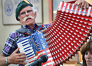 Robert Leonard of the Slippery Sneakers band, plays zydeco music with his wet tuned piano accordion during Hot Night In The City at the Worcester Center For Crafts