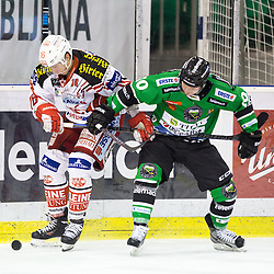 16.12.2014, Hala Tivoli, Ljubljana, SLO, EBEL, HDD Telemach Olimpija Ljubljana vs EC KAC, 28. Runde, in picture Patrick Harand (EC KAC, #16) vs Tom Zanoski (HDD Telemach Olimpija, #10) during the Erste Bank Icehockey League 28. Round between HDD Telemach Olimpija Ljubljana and EC KAC at the Hala Tivoli, Ljubljana, Slovenia on 2014/12/16. Photo by Matic Klansek Velej / Sportida