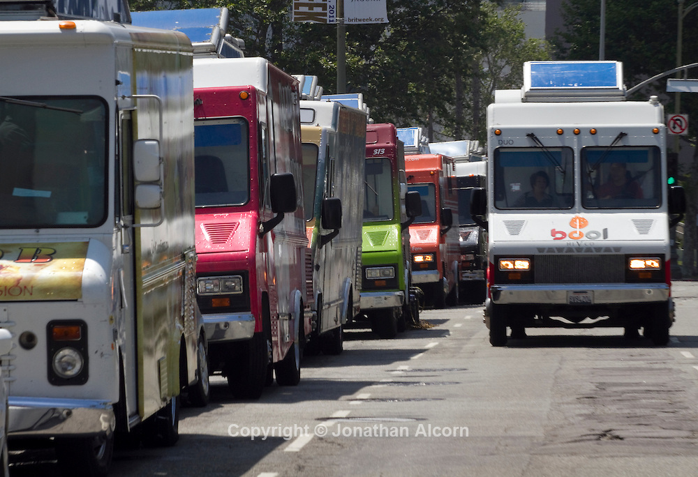 A line of gourmet food trucks on Wilshire Bl. in Los Angeles