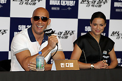 59636420 .U.S. actor Vin Diesel (L) and actress Michelle Rodriguez attend a press conference for the premiere of the movie Fast and Furious 6 in Seoul, South Korea, May 13, 2013. Photo by: i-Images.UK ONLY