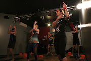 NEW YORK CITY, NEW YORK, MARCH 30, 2016. Caryn Havlik and the Metal Bones Yoga participants giving the finger. The class takes place at 6:30 p.m. on Wednesdays at The Cobra Club in Bushwick, Brooklyn. 03/30/2016. Photo by Donna M. Airoldi/NYC News Service