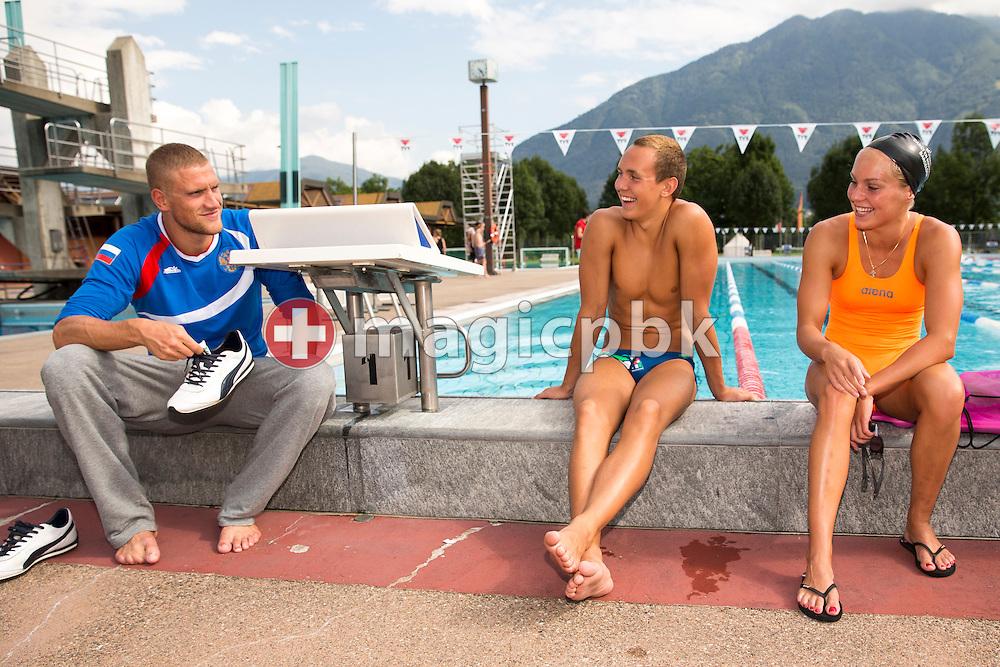 Swimmers Andrey GRECHIN (L-R), Vladimir POPOV and Sasha TOURETSKI are pictured poolside at the Centro sportivo nazionale della gioventu in Tenero, Switzerland, Saturday, Aug. 9, 2014. (Photo by Patrick B. Kraemer / MAGICPBK)