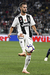 September 26, 2018 - Turin, Italy - Juventus midfielder Miralem Pjanic (5) reaches for the ball during the Serie A football match n.6 JUVENTUS - BOLOGNA on 26/09/2018 at the Allianz Stadium in Turin, Italy. (Credit Image: © Matteo Bottanelli/NurPhoto/ZUMA Press)