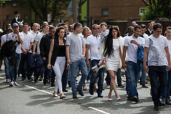 "© Licensed to London News Pictures . 28/08/2015 . Salford , UK . The procession passes along Liverpool Street , watched by people lining the pavements . The funeral of Paul Massey at St Paul's CE Church in Salford . Massey , known as Salford's "" Mr Big "" , was shot dead at his home in Salford last month . Photo credit : Joel Goodman/LNP"