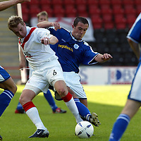 Airdrie v St Johnstone...07.08.04<br />David Dunn is tackled by David Hannah<br /><br />Picture by Graeme Hart.<br />Copyright Perthshire Picture Agency<br />Tel: 01738 623350  Mobile: 07990 594431