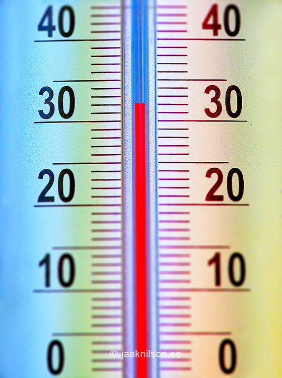 Close up of thermometer measuring 32 degrees Celsius or Fahrenheit. 32 F is  equivalent to 0 C. Measuring temperature with thermometer and comparing two different systems of measurement.